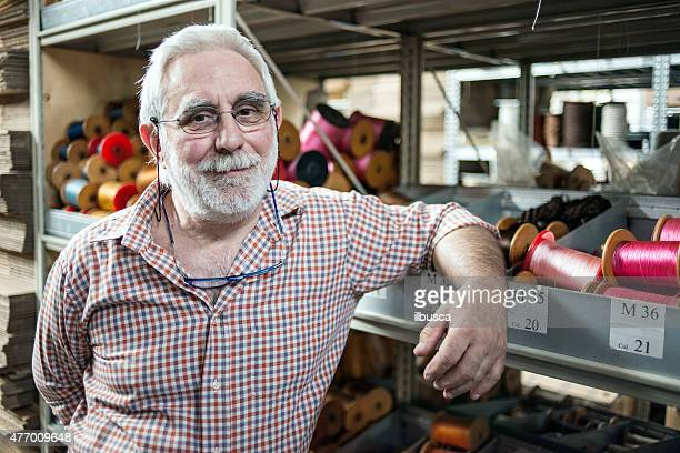 Mature man in his artisanal handicraft traditional textile factory