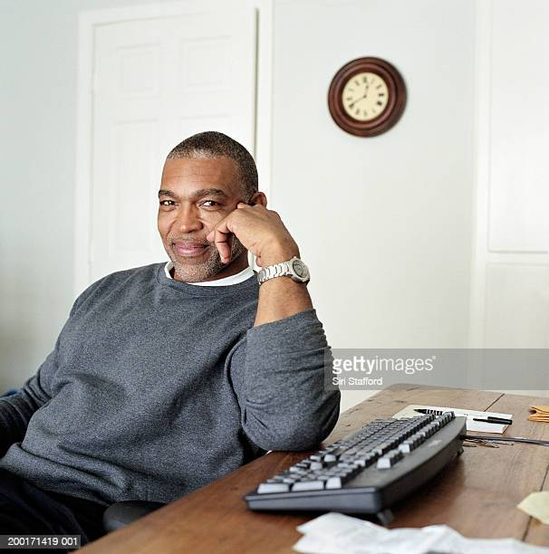 Mature man in home office, portrait
