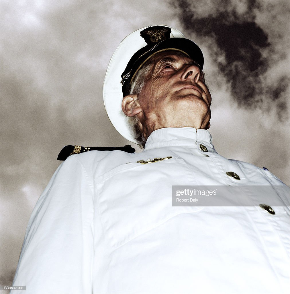 Mature man in military uniform, low angle view : Stock Photo