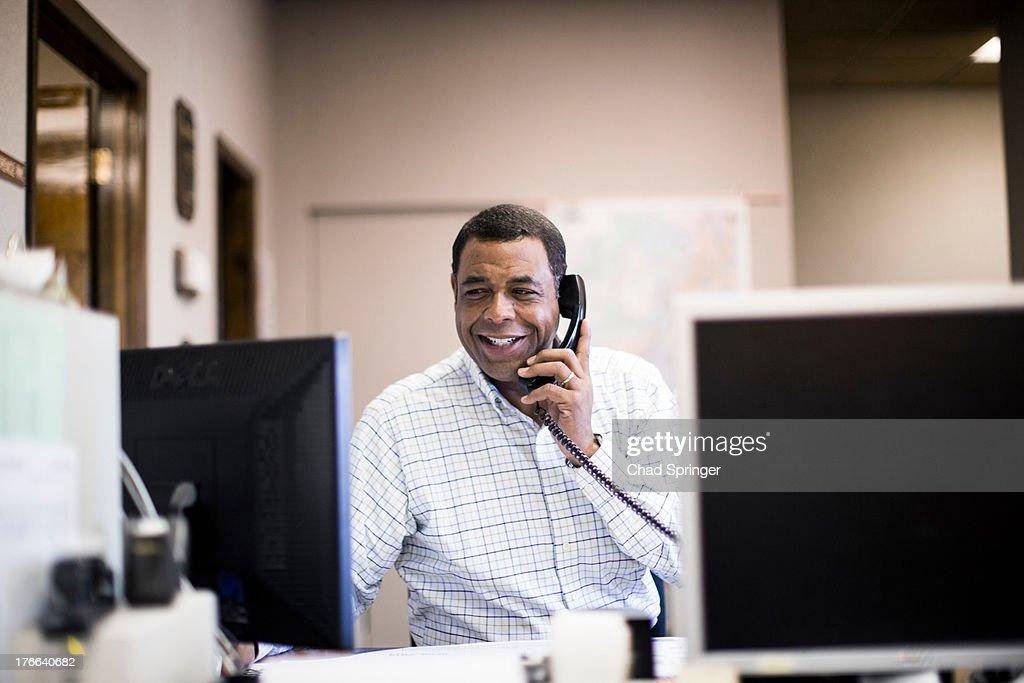 Mature man in office on landline