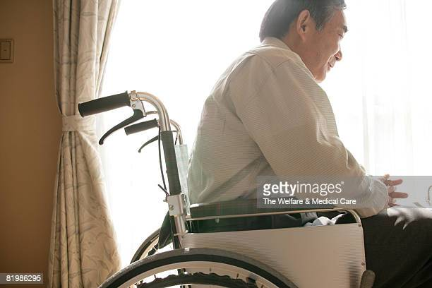 Mature man in wheelchair, smiling