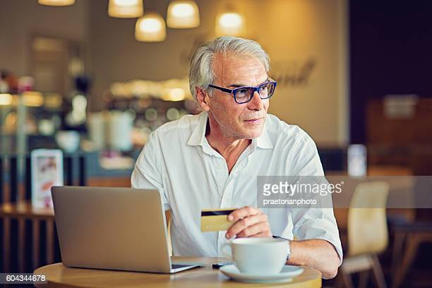 Mature man is shopping in the Internet