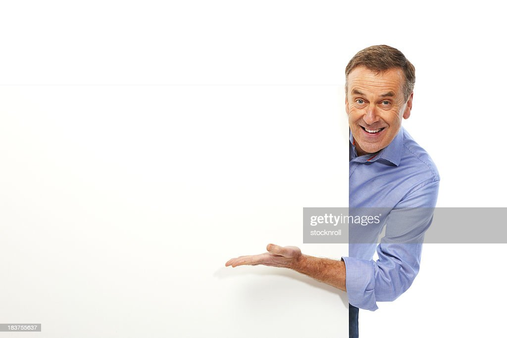 Mature man isolated on white background holding board