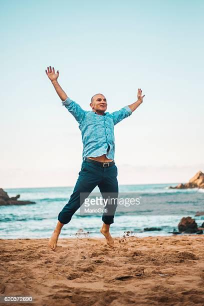 Mature man jumping