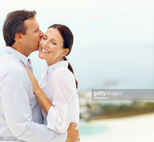Mature man kissing his wife