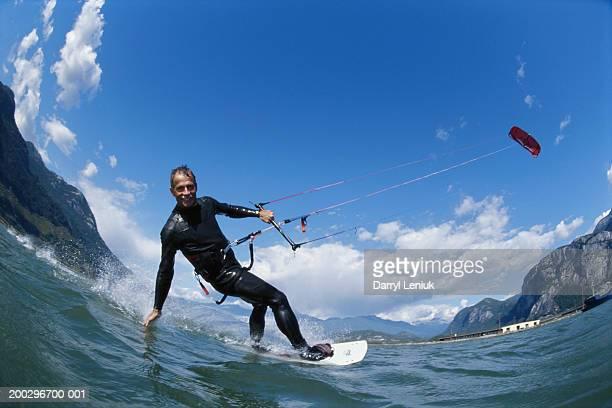 Mature man kiteboarding, smiling, portrait (fish eye)