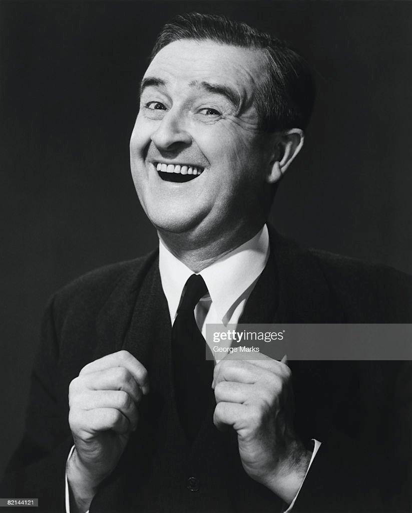 Mature man laughing in studio, (B&W), portrait : ストックフォト