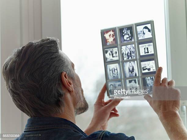 Mature man looking at old slides