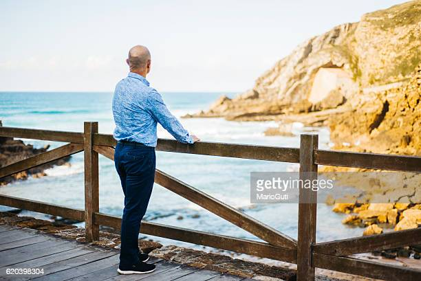 Mature man looking at the sea