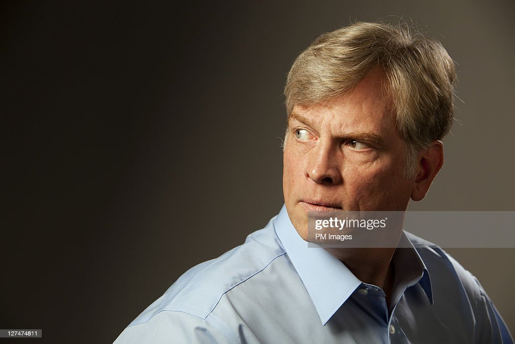 Mature man looking over shoulder