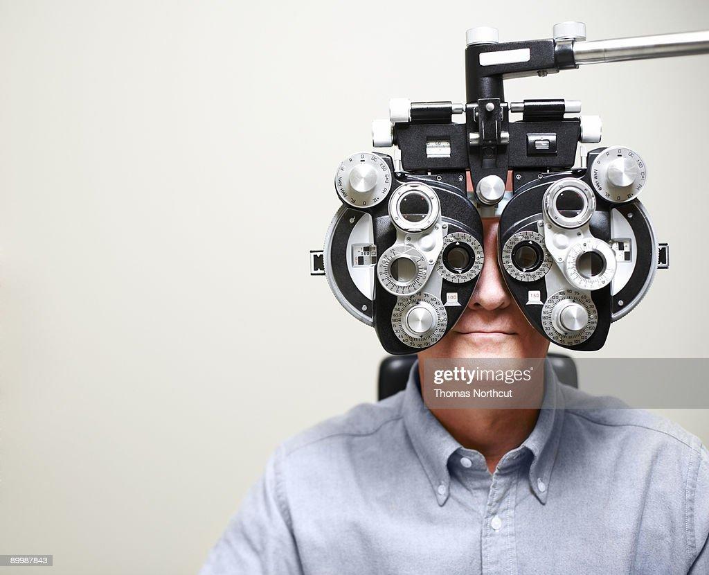 Mature Man looking through Phoroptor