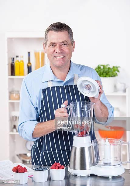Mature Man Making Smoothie / Dessert