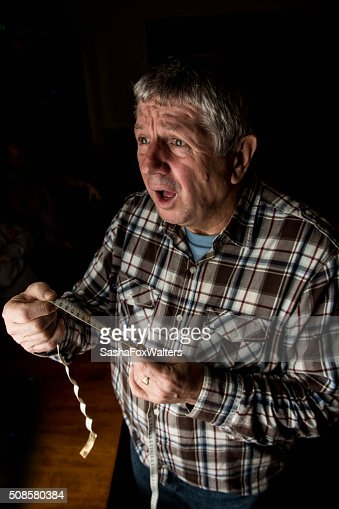 mature man measuring waistline : Stock Photo