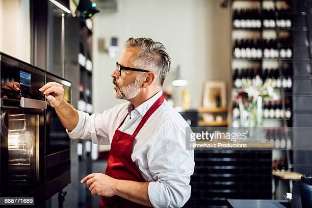 Mature man on a modern stove