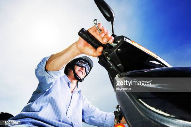 Mature man on a motorbike