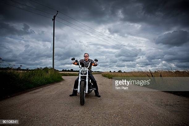 Mature man on a motorcycle.