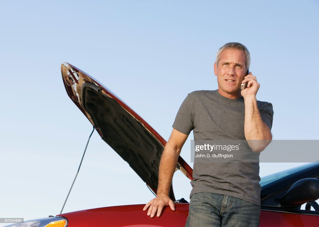 Mature man on cell phone with car breakdown : Stock Photo