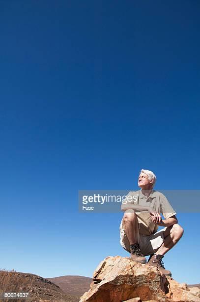 Mature Man on Mountain Peak