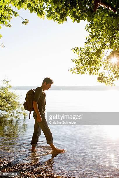 Mature man paddling in Lake Starnberg, Bavaria, Germany