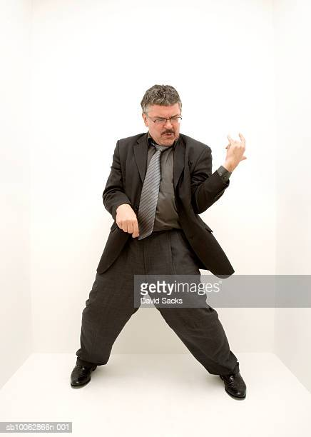 Mature man playing air guitar, high angle view