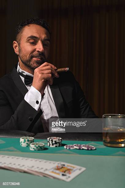 Mature man playing at the poker table