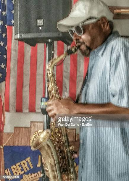 Mature Man Playing Saxophone At Event