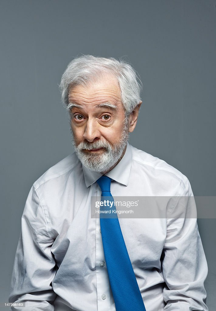 mature man portrait looking questioning : Stock Photo