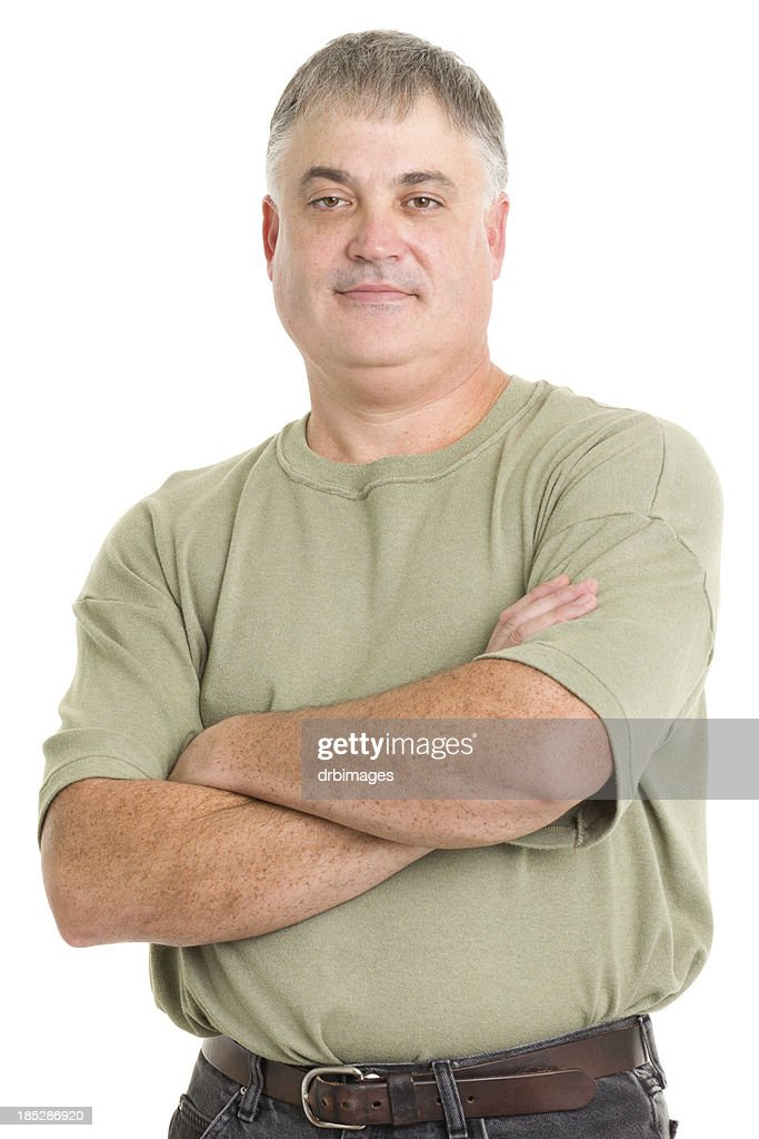 Mature Man Poses With Arms Crossed