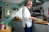 Mature man preparing food in kitchen
