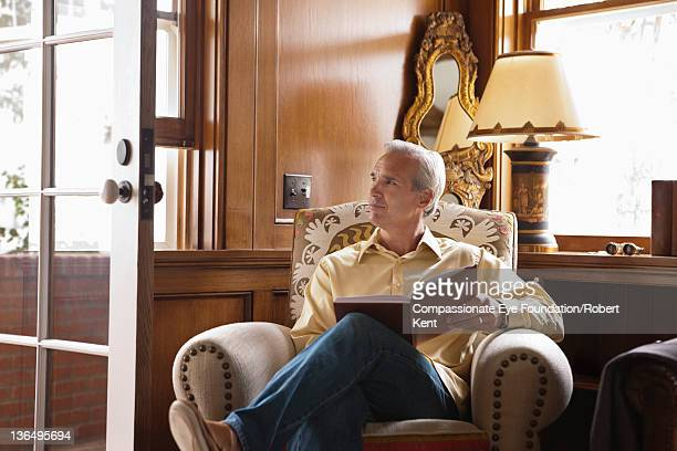 Mature man reading in home office