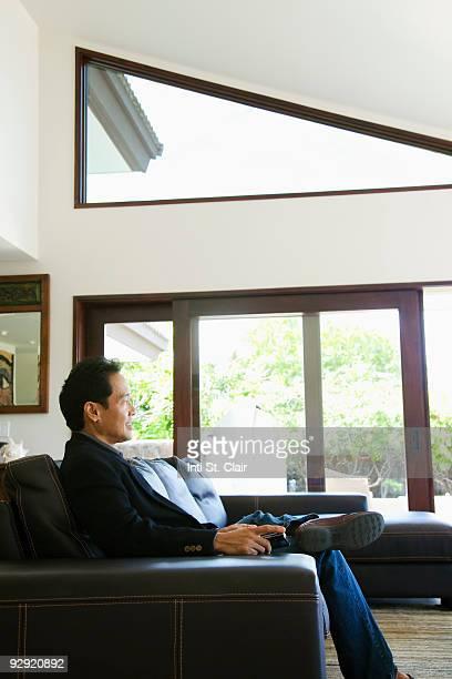 Mature man relaxing in living room