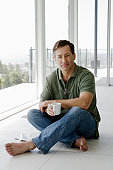 Mature man relaxing with coffee cup