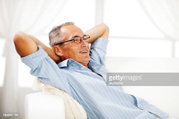 Mature man resting at home.