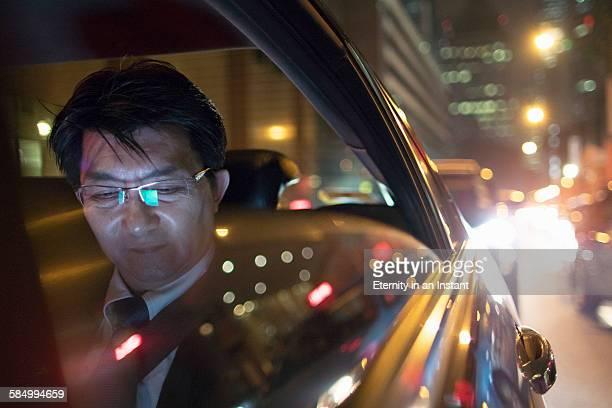 Mature man riding in a car