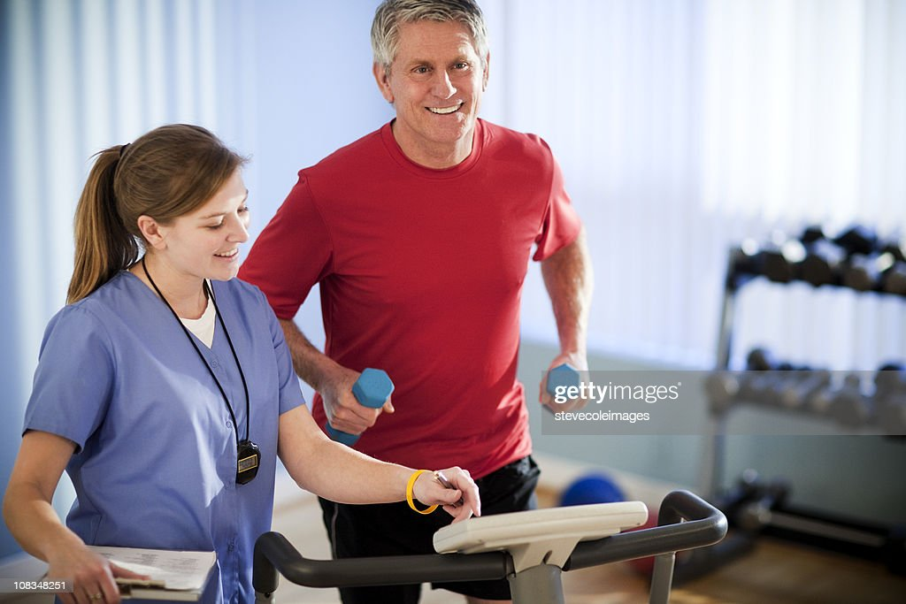 Mature Man Running With Dumbbells for Physical Therapy : Stock Photo