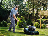 Mature Man/ Senior Mowing The Lawn