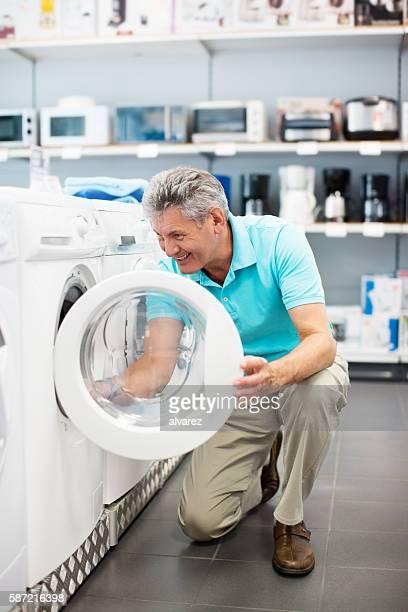 Mature man shopping for a washing machine