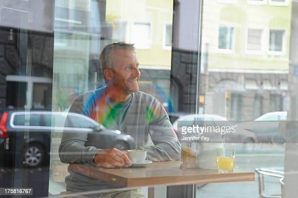 Mature man sitting in coffee shop