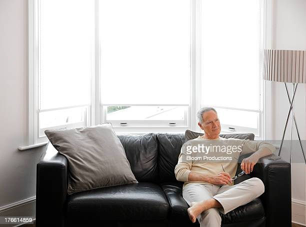 Mature man sitting on a sofa