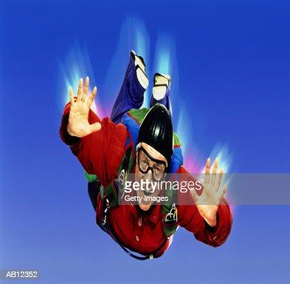 Mature man skydiving, digitally enhanced : Stock Photo