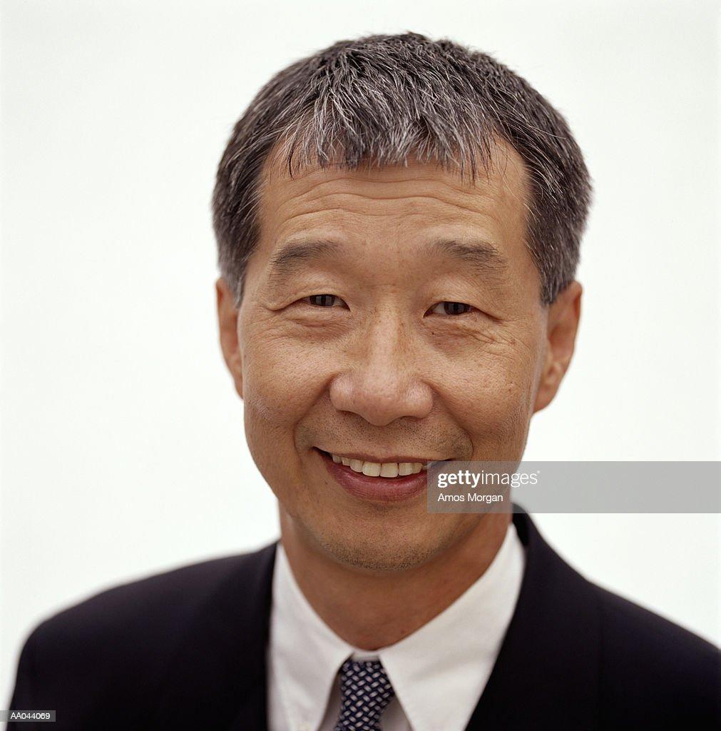 Mature man smiling, close-up, portrait : Stock Photo