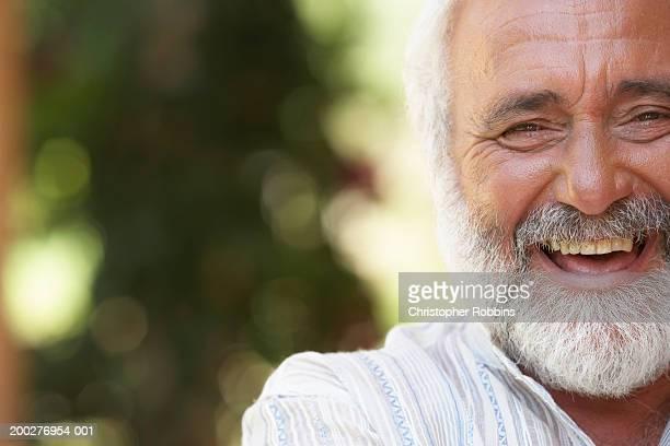 Mature man smiling, portrait, close-up