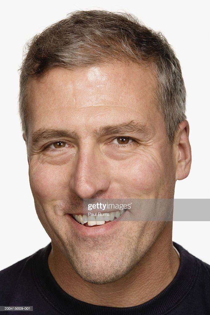 Mature man smiling, portrait, close-up : Stock Photo
