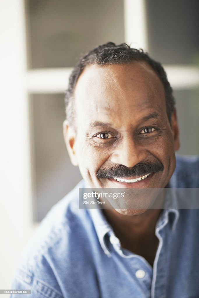Mature man smiling, portrait : Stock Photo