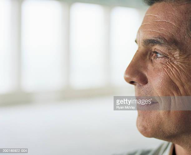 Mature man smiling, side view