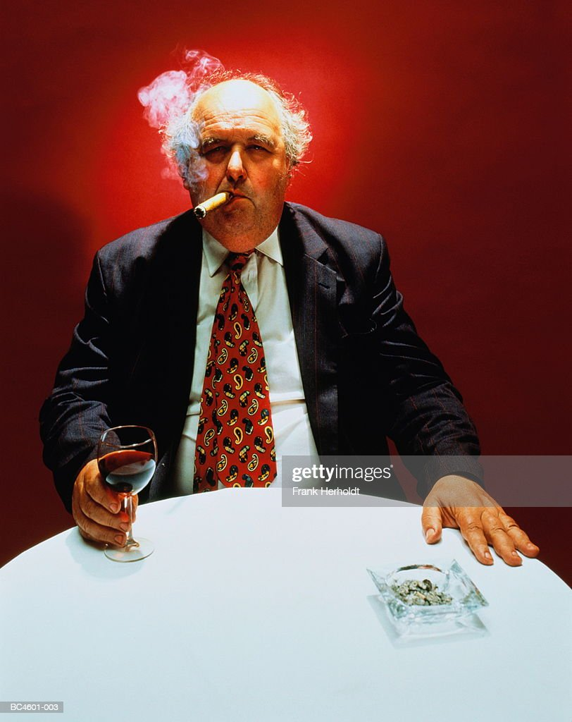 Mature man smoking cigar at restaurant table (Enhancement) : Stock Photo