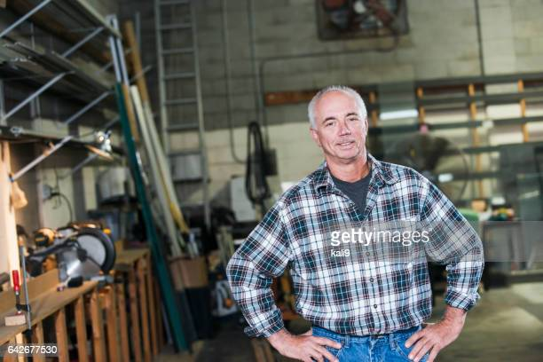 Mature man standing in factory workshop