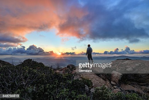 Mature man standing on a mountain at sunset, Cleveland National Forest, USA