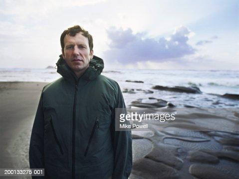 Mature man standing on beach, portrait