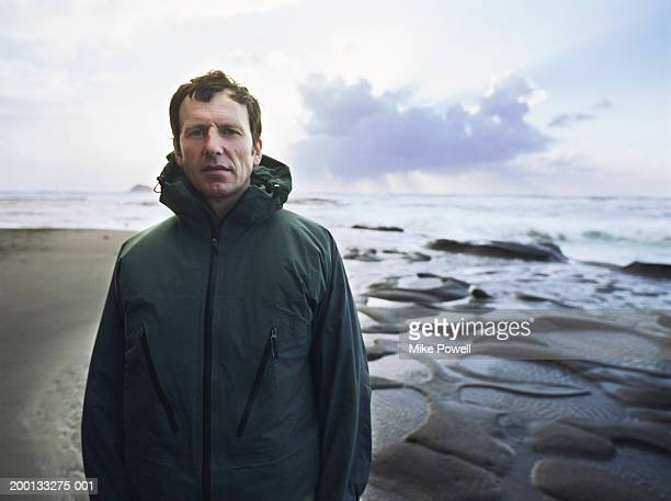 Mature man standing on beach, portrait
